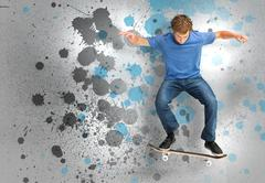 Male skateboarder doing an ollie trick Stock Photos