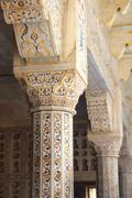 marble columns in red agra fort - stock photo