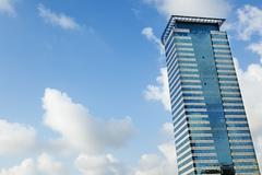 Office building & cloudy sky Stock Photos