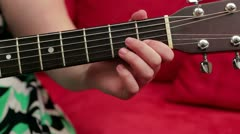 Fretting a C Chord on the guitar Stock Footage