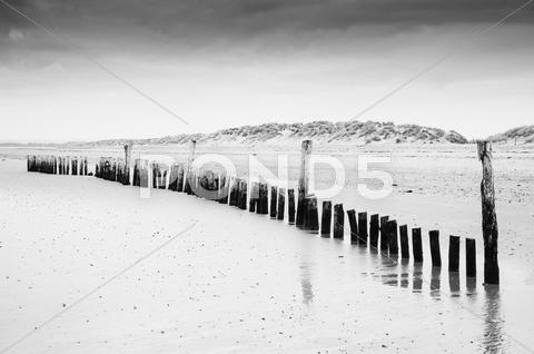 Stock photo of black and white low tide beach landscape