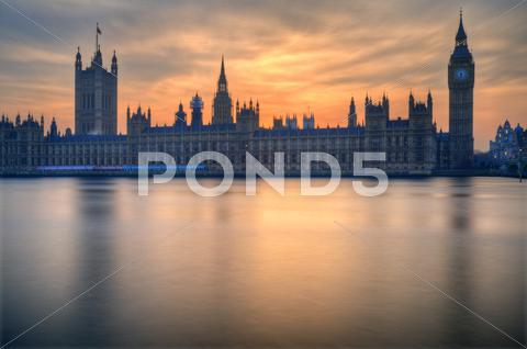 Stock photo of big ben and houses of parliament london during winter sunset.