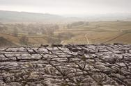 Autumn morning over liomestone pavement at malham cove looking along malham d Stock Photos