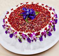 Strawberry cake decorated with purple flowers Stock Photos