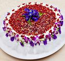 Stock Photo of strawberry cake decorated with purple flowers