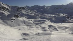 Aerial view snow covered mountains and skiing area Stock Footage
