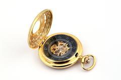Gold pocket watch. Stock Photos