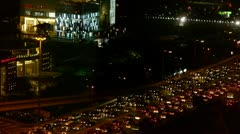 nighttime traffic pollution in Beijing CBD,cars jam troop slow moving. - stock footage