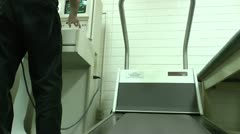Medical Assistant Sets Up Medical Treadmill Stress Test Stock Footage