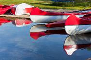Stock Photo of red and white canoes and boats