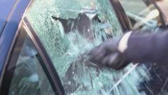 Smashing car window - stealing - HD Stock Footage