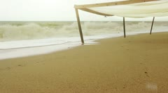 Destroyed beach canopy after snorter Stock Footage