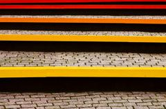 colored benches and pavers - stock photo