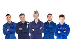 Mechanics in boiler suits portrait - stock photo