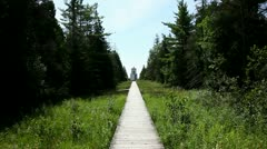 WOODEN TRAIL LEADING TO OLD LIGHTHOUSE Stock Footage