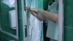Stock Video Footage of Surgeon washing hands before operation