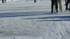 People skate ice outdoor frozen lake pond cold winter day Stock Footage