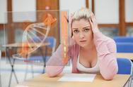 Blonde woman thinking hard while studying on interface with DNA Stock Illustration