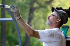 painter brush man - stock photo