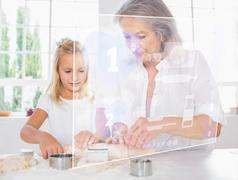 Grandmother and granddaughter baking with white interface - stock illustration