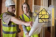 Architect and foreman consulting the plans on interface Stock Illustration
