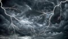 Dark, ominous rain clouds and lightning - stock photo