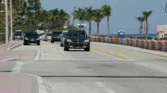 Time lapse footage of cars driving along A1A Stock Footage