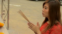 Thai Woman Praying with Incense at a Temple - stock footage