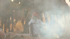 Tribesmen cooking Camel Fair, Pushkar, India Stock Footage