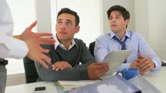 Multi-ethnic businessmen listening to direction from female manager Stock Footage
