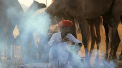 Tribesmen cooking Camel Fair, Pushkar, India Stock Footage