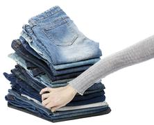 Hand arranging jeans stack Stock Photos