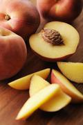 Peaches and peach pit Stock Photos