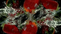 Fresh strawberry fruit dropped into water Stock Footage