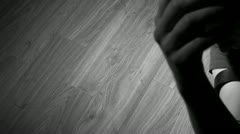 Heroin addict dropping dead in black and white - stock footage