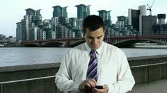 Young Businessman Smartphone at Thames River London 4 720 Stock Footage