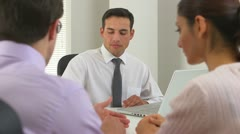 Latino businessman advising couple - stock footage