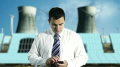 Young Businessman Touchscreen Phone Energy Concept 1 720 Stock Footage