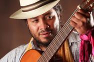 Rastafarian Man Playing Trombone Wearing A Panama Hat Stock Photos