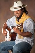 Rastafarian Man Playing Classic Guitar - stock photo