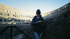 Woman using tablet inside the colosseum - stock footage