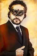 mysterious sexy man with artistic style with  venetian mask - stock photo