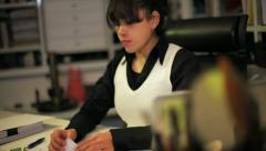 Latina business woman in her office Stock Footage