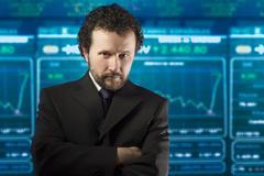 Liikemies, jolla on parta ja musta puku stockmarket Kuvituskuvat