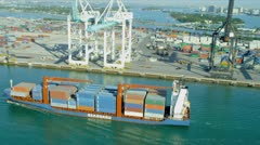 Aerial view PortMiami loaded container cargo vessel, USA Stock Footage