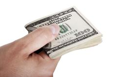giving out cash - folded - stock photo