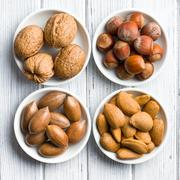 various nuts in ceramic bowls - stock photo