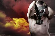 Stock Photo of portrait of a man in a polluted ambience with gas mask