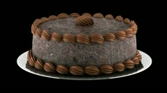 Round chocolate cake loop rotate on black background Stock Footage