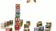 Autism ribbon falling beside blocks spelling autism Stock Footage